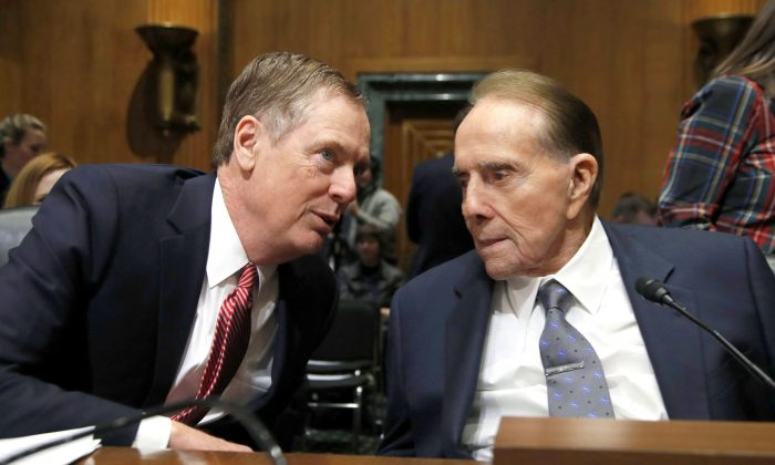U.S. Trade Representative-nominee Robert Lighthizer (L) talks to former senator Bob Dole during his confirmation hearing on Capitol Hill in Washington, D.C., on March 14, 2017. (AP Photo/Manuel Balce Ceneta)