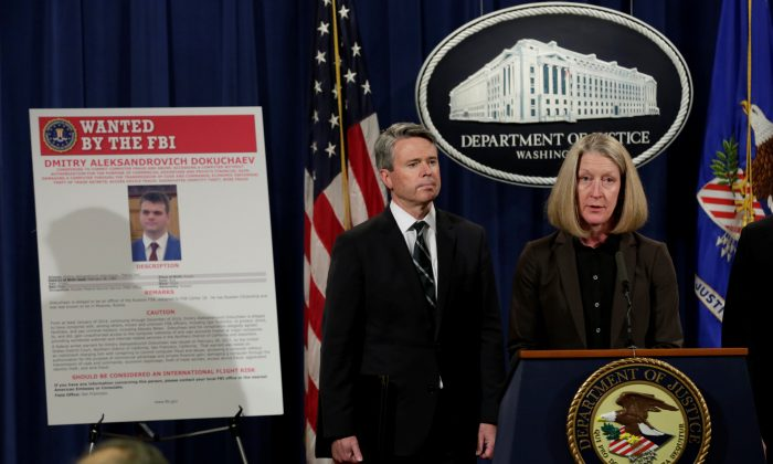 Acting AAG for National Security Mary McCord speaks in front of a poster of a suspected Russian hacker during FBI National Security Division and the U.S. Attorney's Office for the Northern District of California joint news conference at the Justice Department in Washington, U.S. on March 15, 2017. (REUTERS/Yuri Gripas)