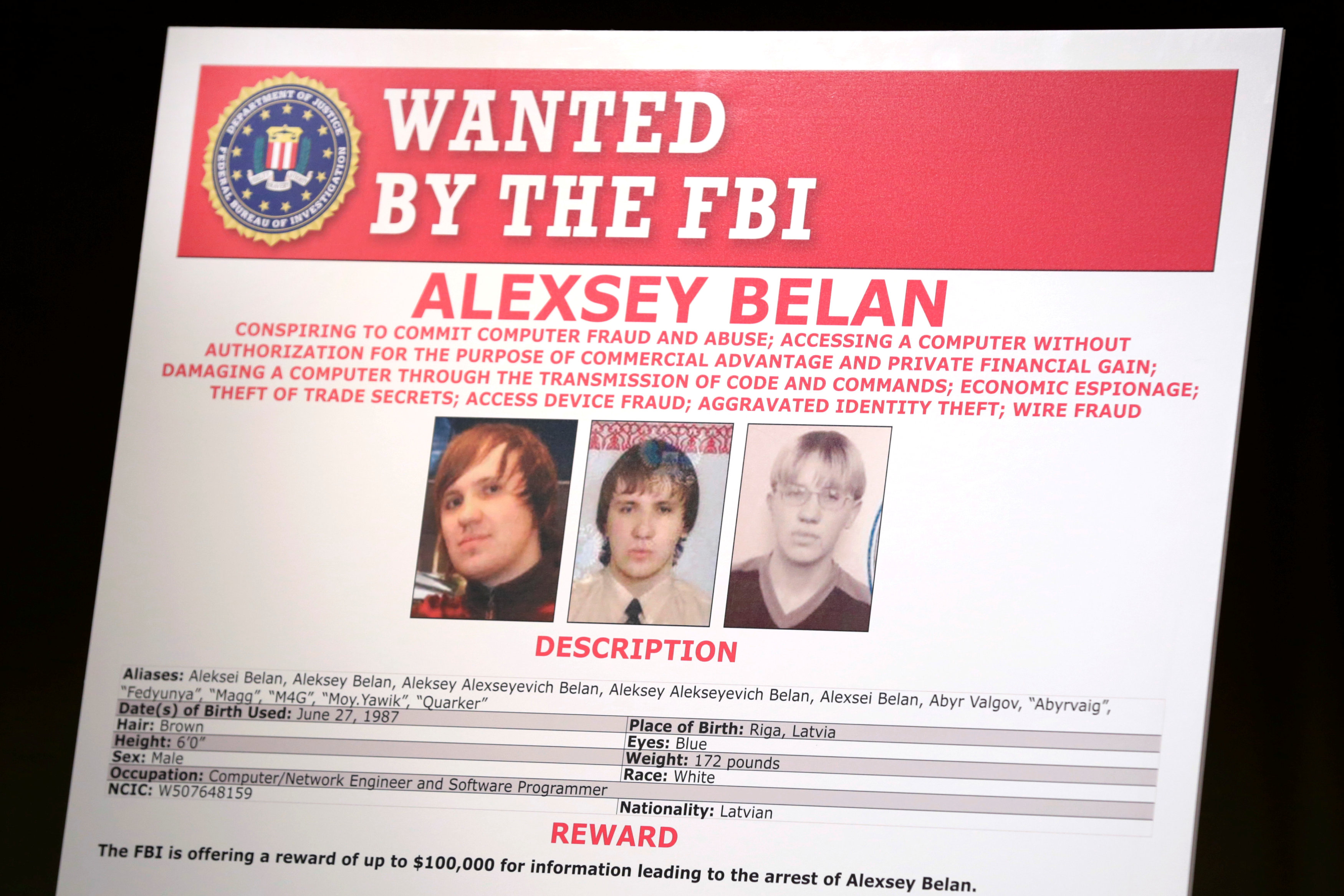 A poster of suspected Russian hackers is seen before FBI National Security Division and the U.S. Attorney's Office for the Northern District of California joint news conference at the Justice Department in Washington, U.S. on March 15, 2017. (REUTERS/Yuri Gripas)