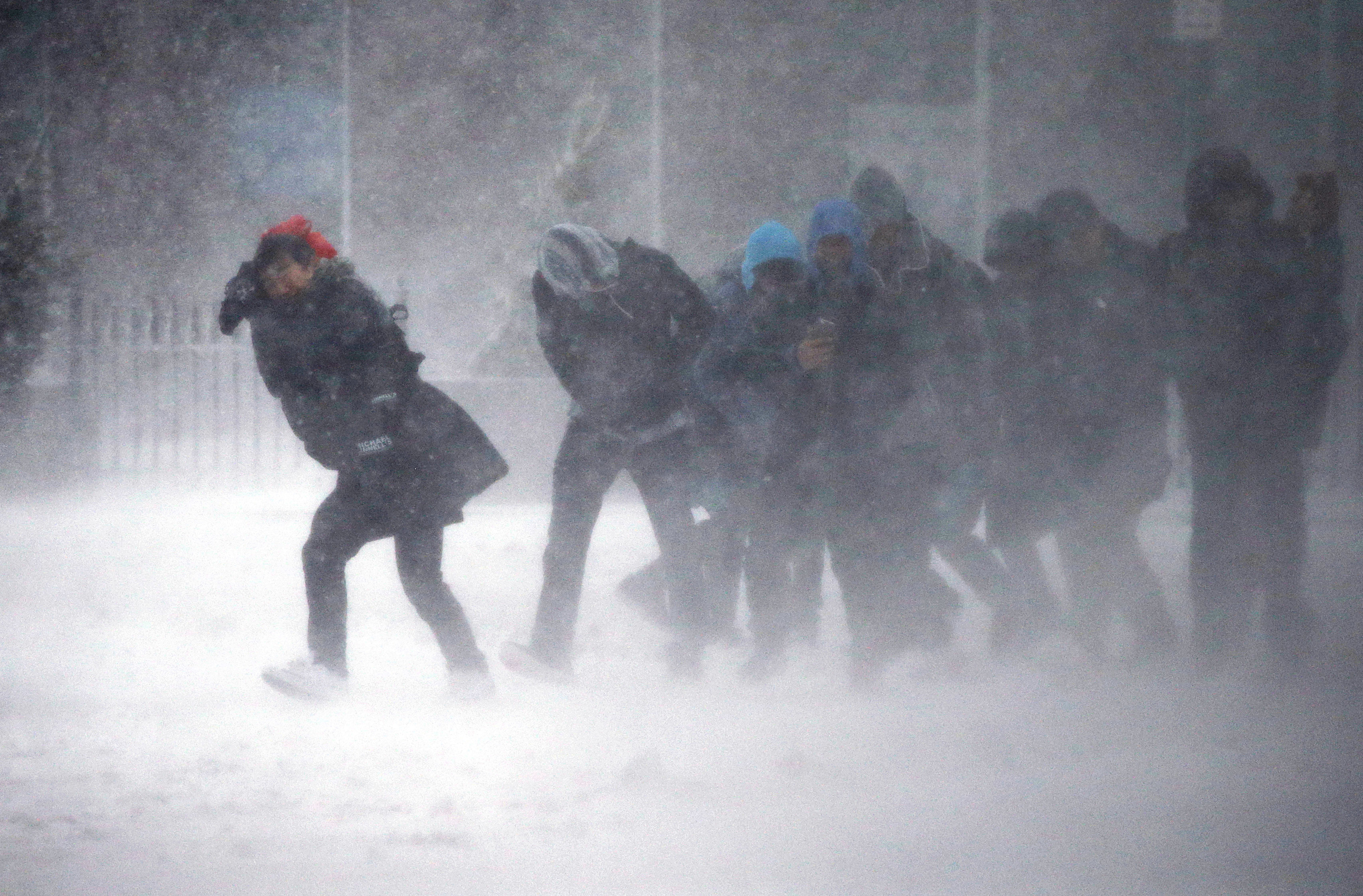 People struggle to walk in the blowing snow during a winter storm in Boston on March 14, 2017. (AP Photo/Michael Dwyer)