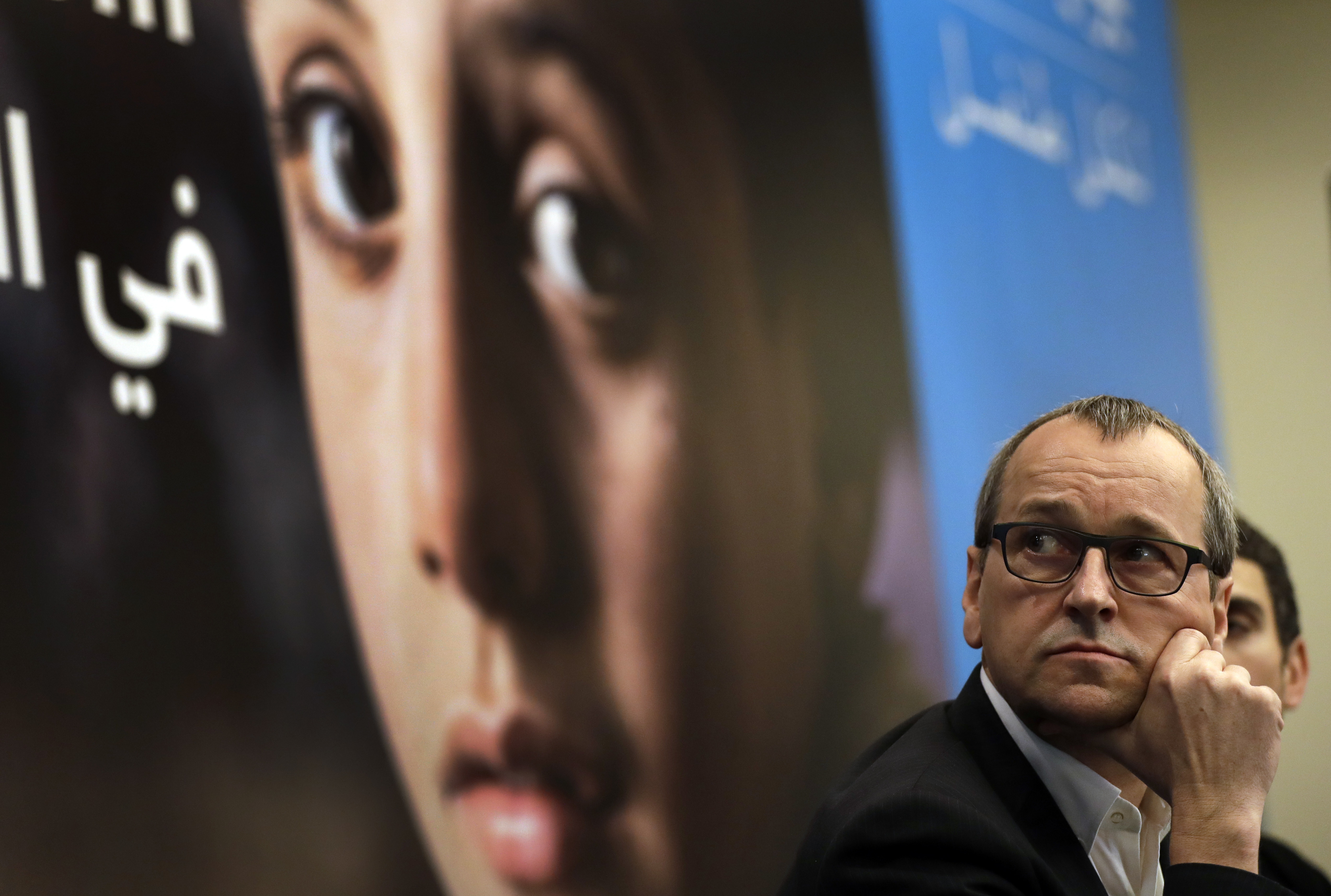 Geert Cappelaere, the U.N. Children's agency (UNICEF) regional director the Middle East and North Africa, watches a video clip on Syrian children during a press conference, in Beirut, Lebanon on March 15, 2017.  (AP Photo/Hussein Malla)