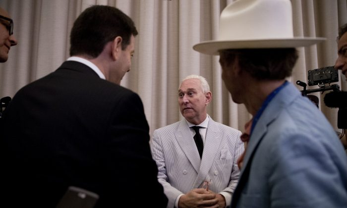 Roger Stone, an adviser to Donald Trump (C) speaks to reporters in New York on  July 16, 2016. (AP Photo/Mary Altaffer)