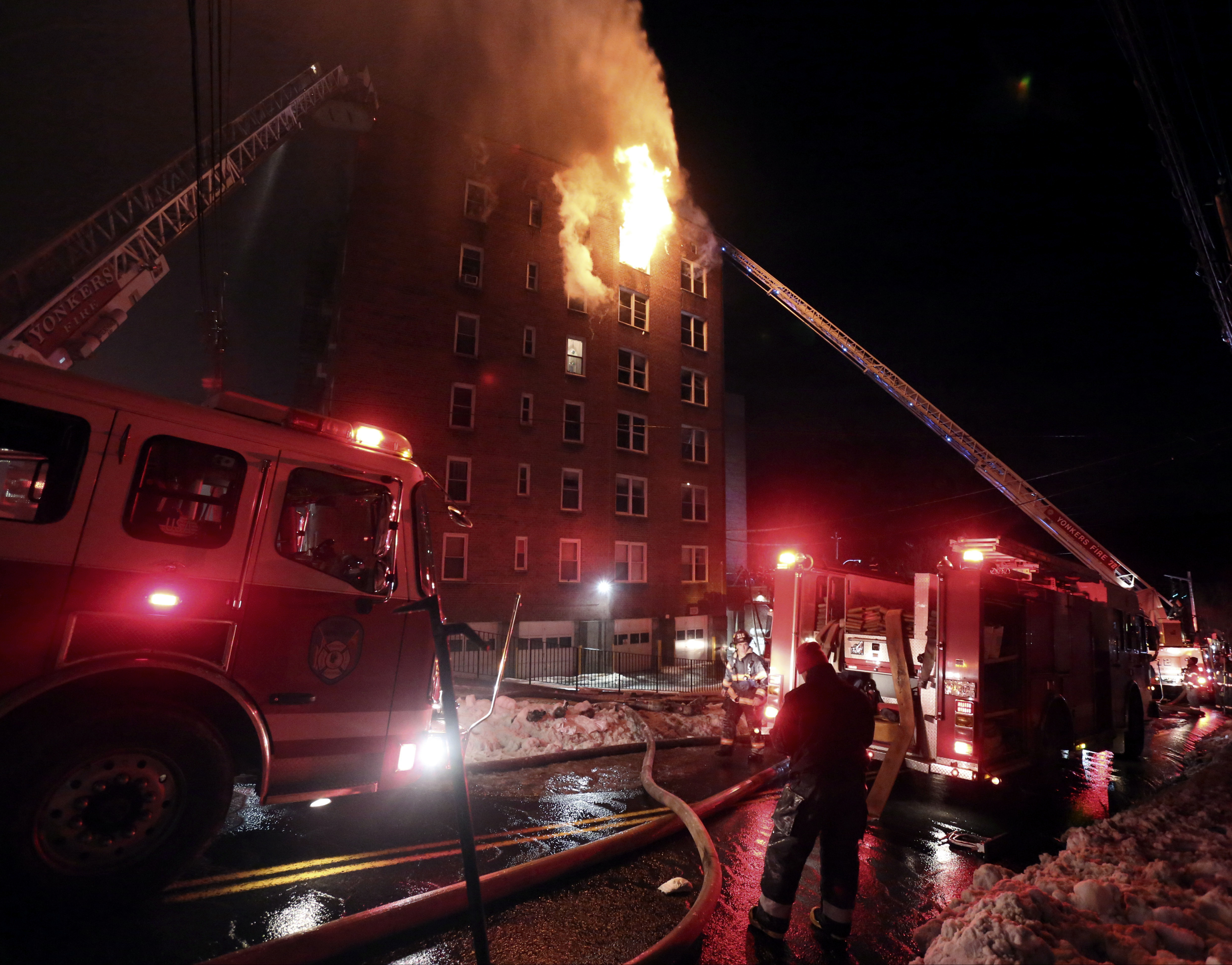 Firefighters battle a fire on the top floor of an apartment building in Yonkers, N.Y., on March 15, 2017. (Mark Vergari/The Journal News via AP)