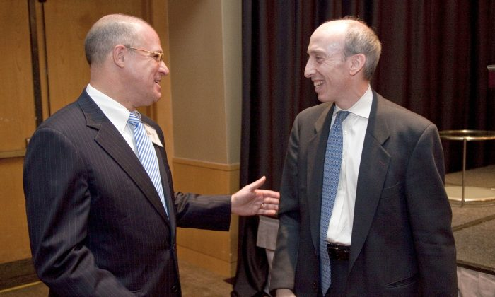 GFI Group Executive Vice President of Corporate Development, J. Christopher Giancarlo (L) talks with Commodity Futures Trading Commission (CFTC) Chairman Gary Gensler during a conference hosted by GFI Group in Washington on Oct. 4, 2010.   (AP Photo/Evan Vucci)