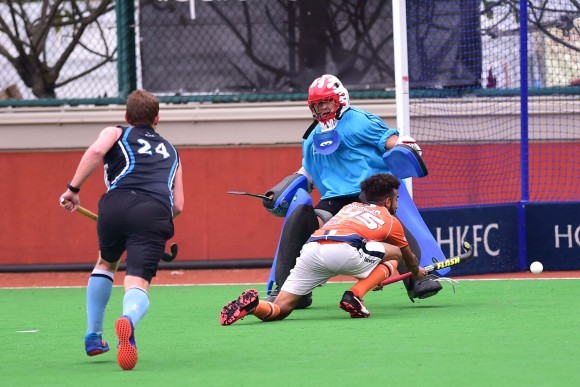 A pass across goal was just missed by Khalsa's Sukhjeet in the match between HKFC and Khalsa on Sunday March 12,2017. (Bill Cox/Epoch Times)