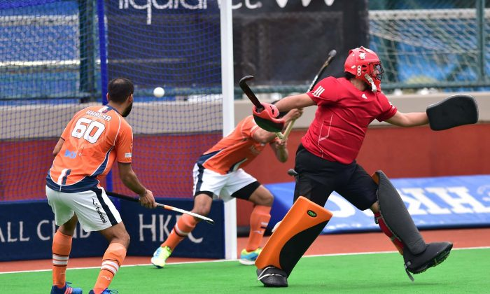 HKFC-A score the winning goal against Khalsa-A at HKFC on Sunday March 12, 2017 to win 3-2. (Bill Cox/Epoch Times)