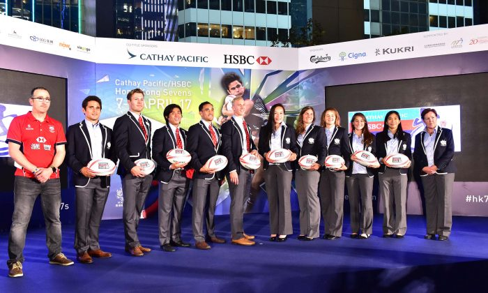 Paul John (L) and Anna Richards (R) with members of the HKG Men's and Women's Rugby 7s Squads at the Sevens draw in Hong Kong on Monday March 13, 2017. (Bill Cox/Epoch Times)