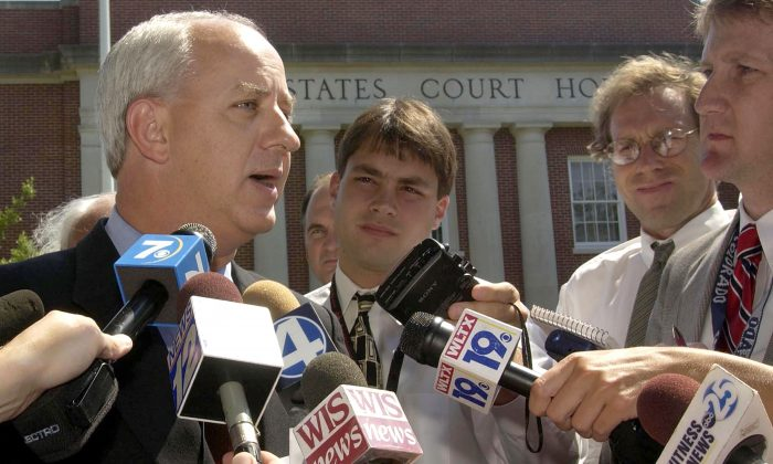 South Carolina Gov. Jim Hodges (L) speaks to the news media after leaving the U.S. Federal Courthouse in Aiken, South Carolina in this  June 13, 2002 file photo. A federal judge denied Hodges' plea to block shipments of weapons-grade plutonium from entering the state. Hodges has threatened to use state troopers to block roads into South Carolina's Savannah River Site nuclear weapons complex, and said he would lie down in the road if necessary to stop the plutonium-carrying trucks.  (Stephen Morton/Getty Images)