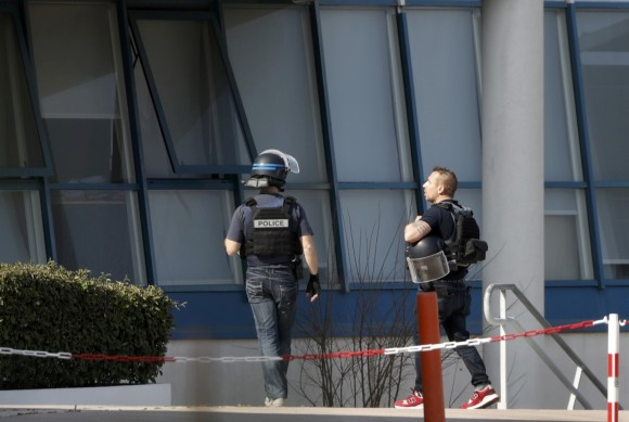 Police inside the Tocqueville high school after a shooting has taken place injuring at least eight people, in Grasse, southern France, March 16, 2017.   (REUTERS/Eric Gaillard)