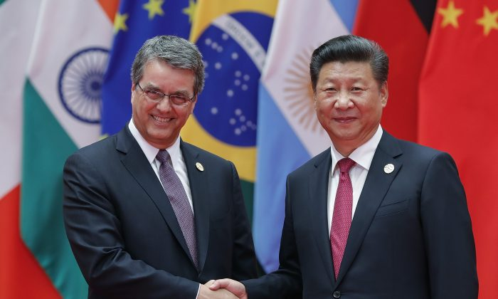 Chinese leader Xi Jinping (right) shakes hands with Director-General of the World Trade Organization Roberto Azevedo to the G20 Summit at the Hangzhou International Expo Center in Hangzhou, China on Sept. 4, 2016. (Lintao Zhang/Getty Images)