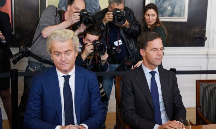 Dutch Prime Minister Mark Rutte (R) and Party for Freedom (PVV) leader Geert Wilders during a meeting of Dutch political party leaders at the House of Representatives in The Hague, Netherlands on March 16, 2017. (Carl Court/Getty Images)