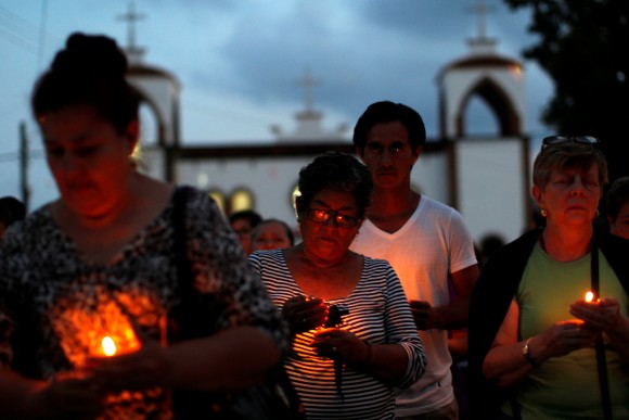 Mothers of missing sons came out of a service of  Pedro Alberto Huesca, whose remains were found at one of the unmarked graves where skulls were found on a plot of land, in Palmas de Abajo, Veracruz, Mexico, on March 16, 2017. (REUTERS/Carlos Jasso)
