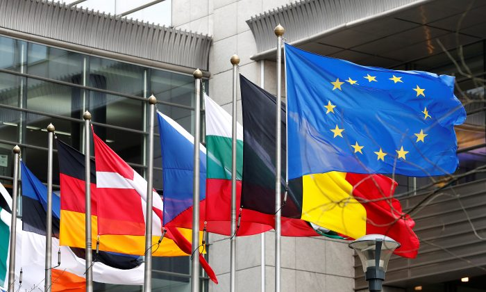 European and national flags fly outside the European Parliament in Brussels, Belgium on March 1, 2017. Although it has added many members since the founding in 1957, the EU has strayed from its original course. (REUTERS/Yves Herman)