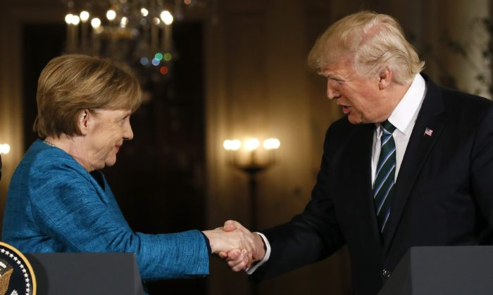 President Donald Trump and German Chancellor Angela Merkel shake hands at the conclusion of their joint news conference in the East Room of the White House in Washington, on March 17, 2017. Europe needs a friendly relationship with the United States. (Reuters/Jim Bourg)