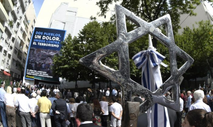 People attend a ceremony to commemorate the 24th anniversary of the bombing of the Israeli Embassy in Buenos Aires, at the Israeli Embassy square in Buenos Aires, on March 17, 2016. The 1992 attack killed 29 people and wounded 200. (JUAN MABROMATA/AFP/Getty Images)