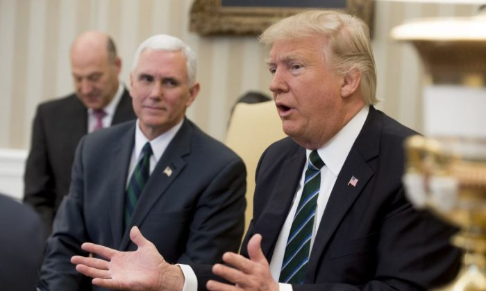US President Donald Trump speaks alongside US Vice President Mike Pence (L) during a meeting about his healthcare plan with members of Congress in the Oval Office of the White House in Washington, DC, on March 17, 2017. (SAUL LOEB/AFP/Getty Images)