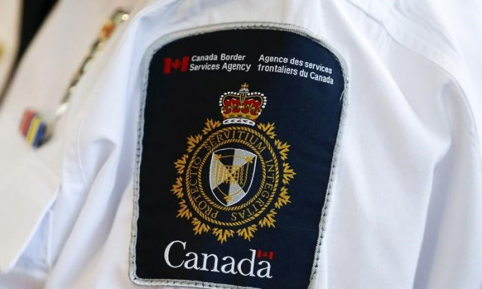 A Canada Border Services Agency (CBSA) logo is seen on a worker during a tour of the Infield Terminal at Toronto Pearson International Airport in Mississauga, Dec.r 8, 2015. (REUTERS/Mark Blinch)