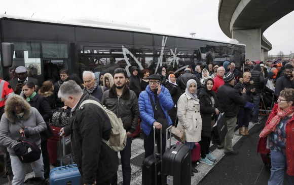 Passengers wait at Orly airport southern terminal after a shooting incident near Paris, France, on March 18, 2017.  (REUTERS/Benoit Tessier)