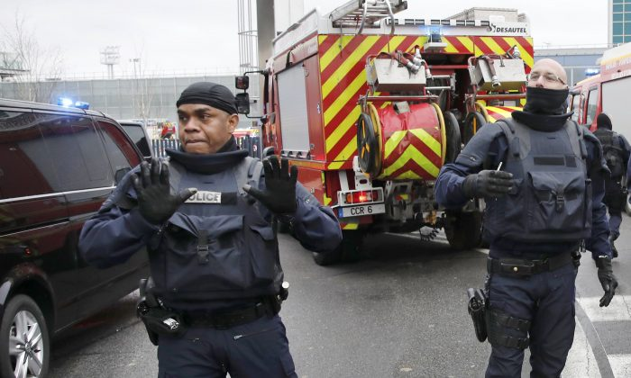 Police at Orly airport southern terminal after a shooting incident near Paris, France, on March 18, 2017. (REUTERS/Benoit Tessier)