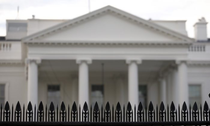 Security fencing at the White House in Washington, Nov. 27, 2015. A man who jumped the White House fence on Thursday, triggering a lockdown of the presidential mansion, was quickly caught and now faces criminal charges, the U.S. Secret Service said. (REUTERS/Carlos Barria)