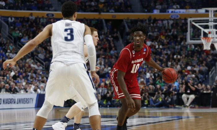 Wisconsin Badgers forward Nigel Hayes (10) dribbles the ball against Villanova Wildcats guard Josh Hart (3) and guard Donte DiVincenzo (behind Hart) in the second half during the second round of the 2017 NCAA Tournament at KeyBank Center, March 18, 2017. (Timothy T. Ludwig-USA TODAY Sports)