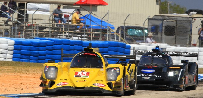 Alex Lynn in the #10 WTR Konica Cadillac chases Chris Miller in the #85 JDC-Miller Oreca 07-Gibson for second  place overall, just before the four-hour mark. (Chris Jasurek/Epoch Tines)