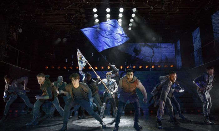 """The company of """"Joan of Arc: Into the Fire,"""" with Jo Lampert (center) as Joan. (Joan Marcus)"""