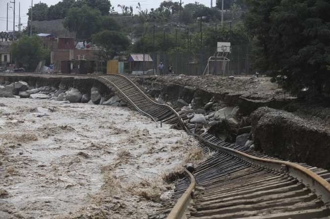 Train tracks are destroyed by a flooded river in the Chosica district of Lima, Peru, on March 19. Intense rains and mudslides over the past three days have wrought havoc around the Andean nation and caught residents in Lima, a desert city of 10 million where it almost never rains, by surprise. (AP Photo/Martin Mejia)