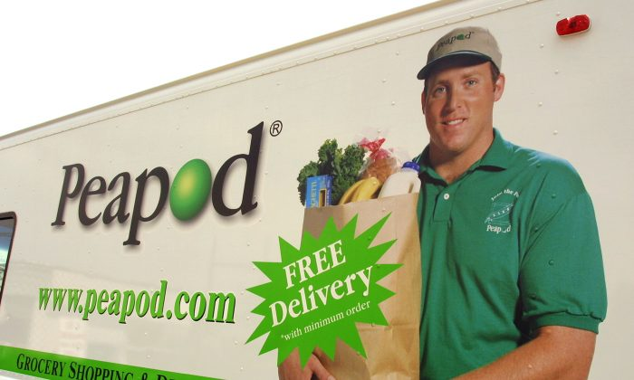 The side of a Peapod grocery delivery truck in Niles, Ill. is seen in a file photo. (Photo by Tim Boyle/Getty Images)