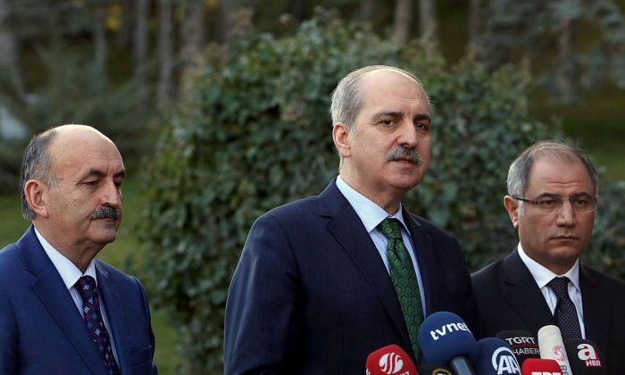 Turkish Deputy Prime Minister Numan Kurtulmus (C) gives a statement flanked by Turkish Interior Minister Efkan Ala (R) and Turkish Health Minister Mehmet Muezzinoglu (L) after a security meeting at the Cankaya Palace in Ankara on Jan. 12, 2016. (ADEM ALTAN/AFP/Getty Images)
