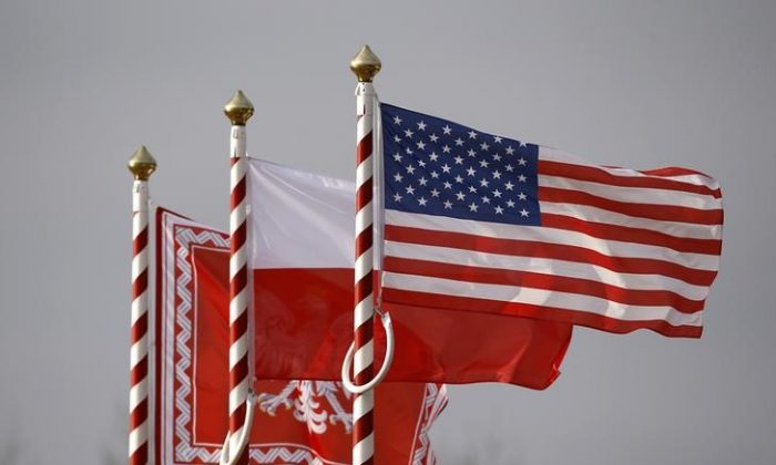 U.S. (R to L), Poland's flags and jack of the President of Poland are seen during the inauguration ceremony of bilateral military training between U.S. and Polish troops in Zagan, Poland, Jan. 30, 2017. (REUTERS/Kacper Pempel)