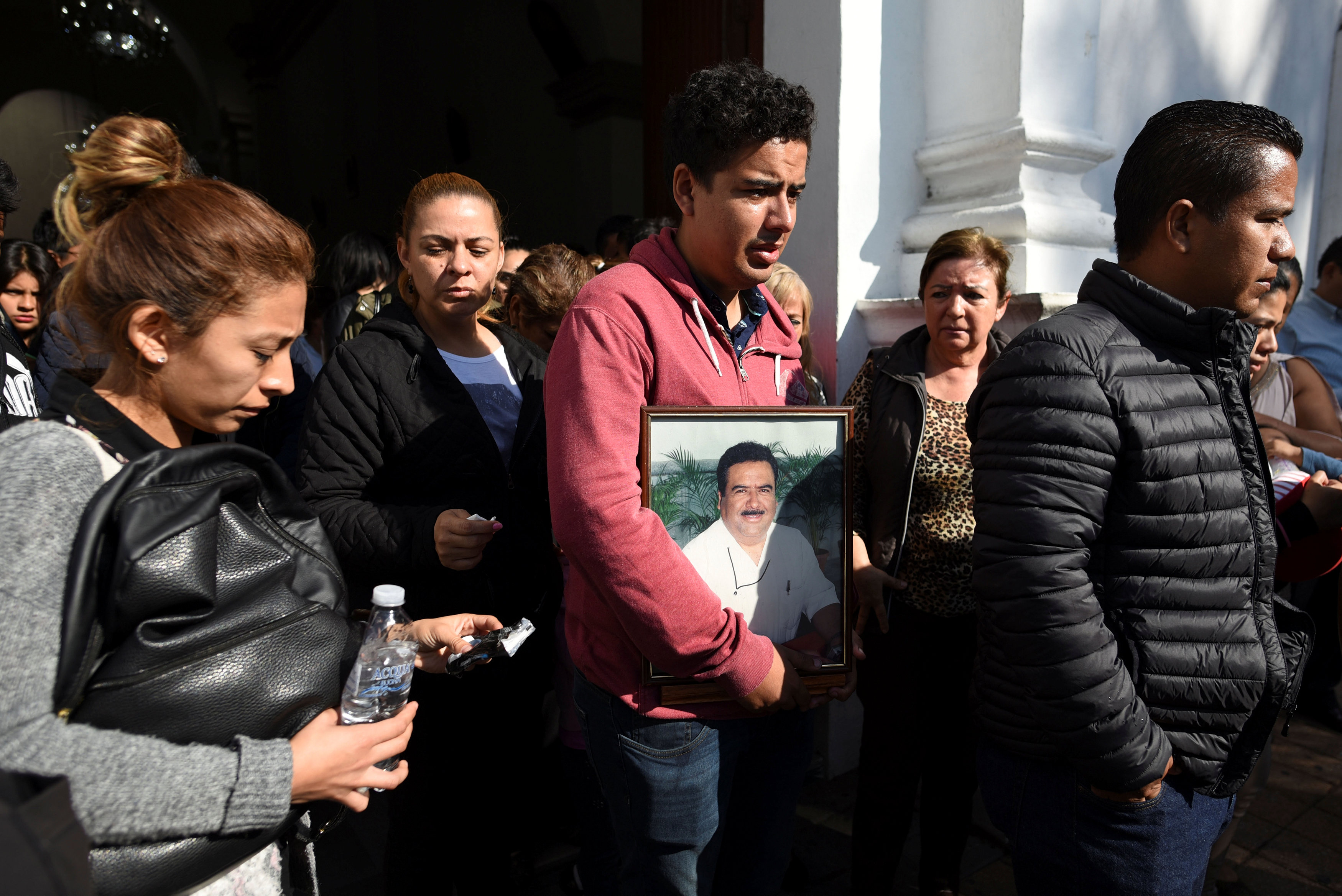 Relatives and friends of slain journalist Ricardo Monlui leave a church after his funeral mass in Cordoba, in the Mexican state of Veracruz, Mexico on March 20, 2017. (REUTERS/Yahir Ceballos)