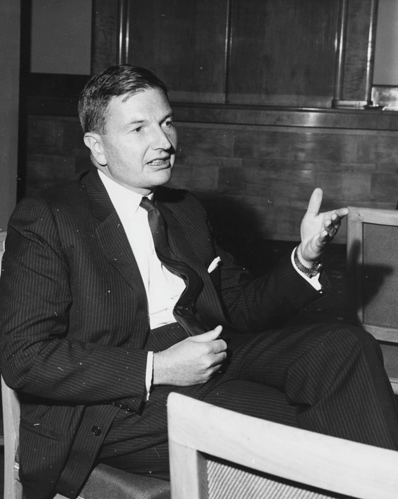 Banker David Rockefeller, Chairman of the Chase Manhattan Corporation, pictured in conversation at the Savoy Hotel during the Chase Investment Forum, London on Oct. 21,1963. (Photo by Moore/Fox Photos/Getty Images)