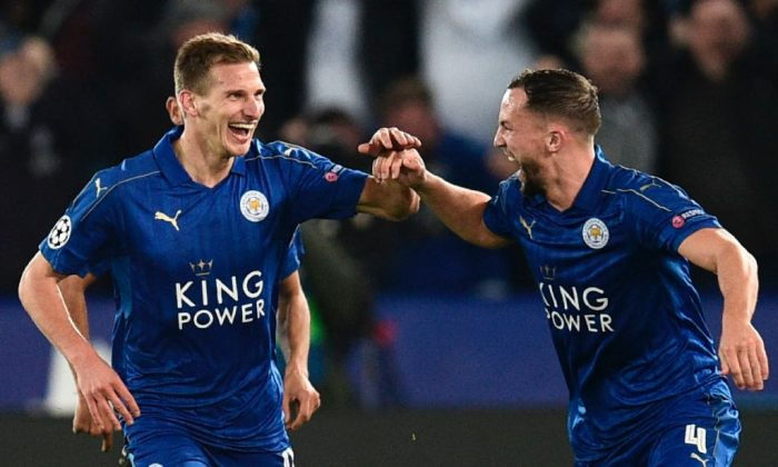Leicester City's English midfielder Marc Albrighton (L) celebrates scoring their second goal with Leicester City's English midfielder Danny Drinkwater (R) during the UEFA Champions League round of 16 second leg football match between Leicester City and Sevilla at the King Power Stadium on March 14, 2017. (Oli Scarff/AFP/Getty Images)