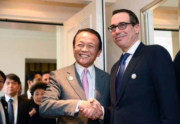US Secretary of the Treasury Steven Mnuchin (R) shakes hands with Japanase Finance Minister Taro Aso prior bilateral talks during the G20 Finance Ministers and Central Bank Governors Meeting in Baden-Baden, southern Germany, on March 17, 2017. Finance ministers from the world's top nations gather in Germany on March 17, as fears grow of a looming trade war over US President Donald Trump's America First policy. (THOMAS KIENZLE/AFP/Getty Images)