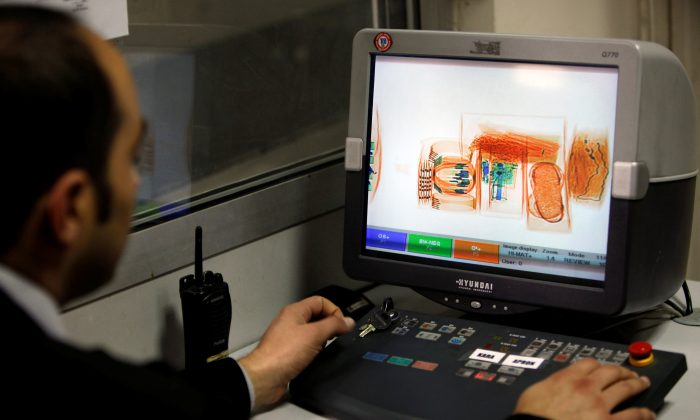 A security official looks at a screen displaying X-ray screened parcels in Turkish Post's (PTT) postal logistic centre at the Ataturk International airport in Istanbul, Turkey on Nov. 6, 2010. (REUTERS/Murad Sezer)