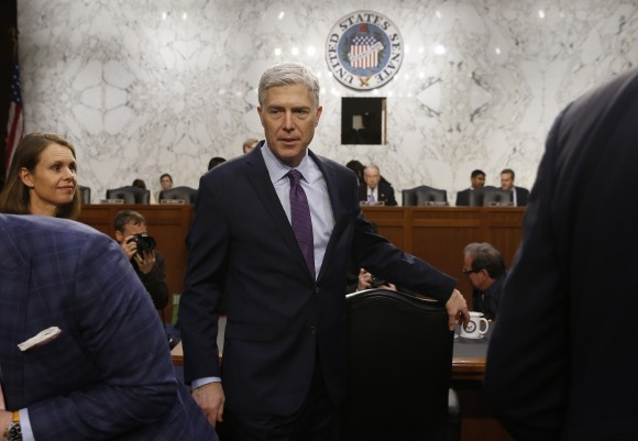 U.S. Supreme Court nominee judge Neil Gorsuch  returns from a break in his testimony at his Senate Judiciary Committee confirmation hearing on Capitol Hill in Washington March 21, 2017. (REUTERS/Jonathan Ernst)