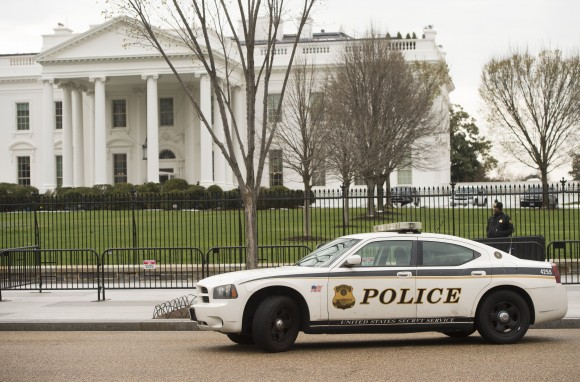 Members of the Secret Service Uniformed Divison patrol alongside the security fence around the perimeter of the White House in Washington on March 18, 2017. A man who scaled a White House fence earlier this month traipsed the grounds of the executive residence for more than 16 minutes prior to his arrest, the US Secret Service said. (SAUL LOEB/AFP/Getty Images)
