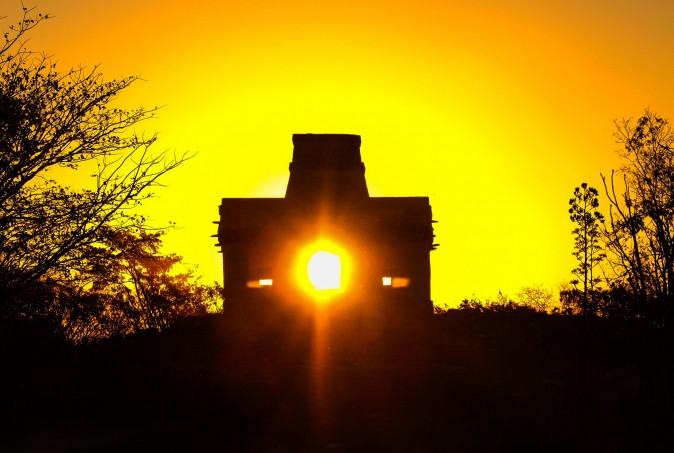 The sun rises through the door of the Seven Dolls Temple, which happens only once a year on the day of the spring equinox, in the Maya Ruins of Dzibilchaltun, in the Mexican state of Yucatan on March 20. (ELIZABETH RUIZ/AFP/Getty Images)