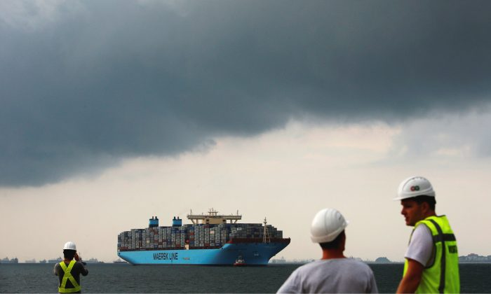 The MV Maersk Mc-Kinney Moller is led by pilot ships as it makes a port of call at a PSA International port terminal in Singapore, Sept. 27, 2013. (REUTERS/Edgar Su/File Photo)