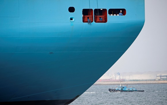 A crew member looks out from the world's largest container ship, the MV Maersk Mc-Kinney Moller as it berths during its maiden port of call at a PSA International port terminal in Singapore, Sept. 27, 2013.     (REUTERS/Edgar Su/File Photo)