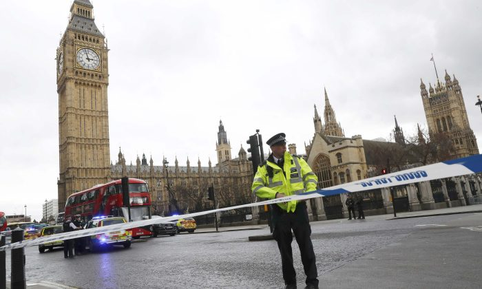 Police tapes off Parliament Square after reports of loud bangs, in London, Britain on March 22, 2017. (REUTERS/Stefan Wermuth)