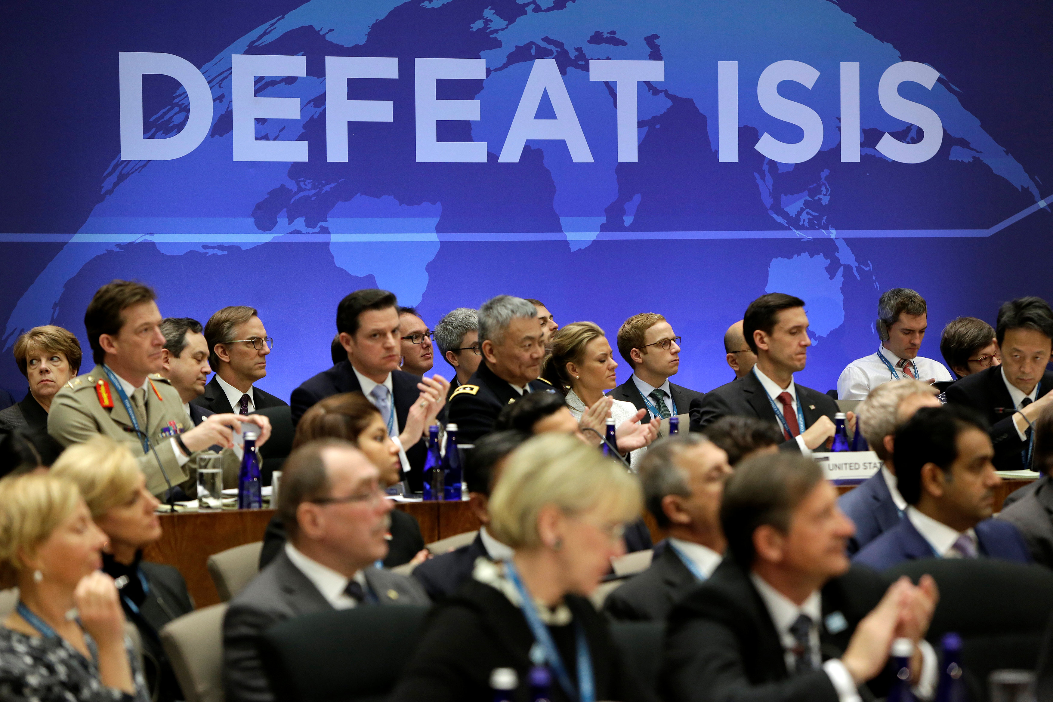 Delegates applaud after remarks at the morning ministerial plenary for the Global Coalition working to Defeat ISIS at the State Department in Washington, U.S. on March 22, 2017. (REUTERS/Joshua Roberts)