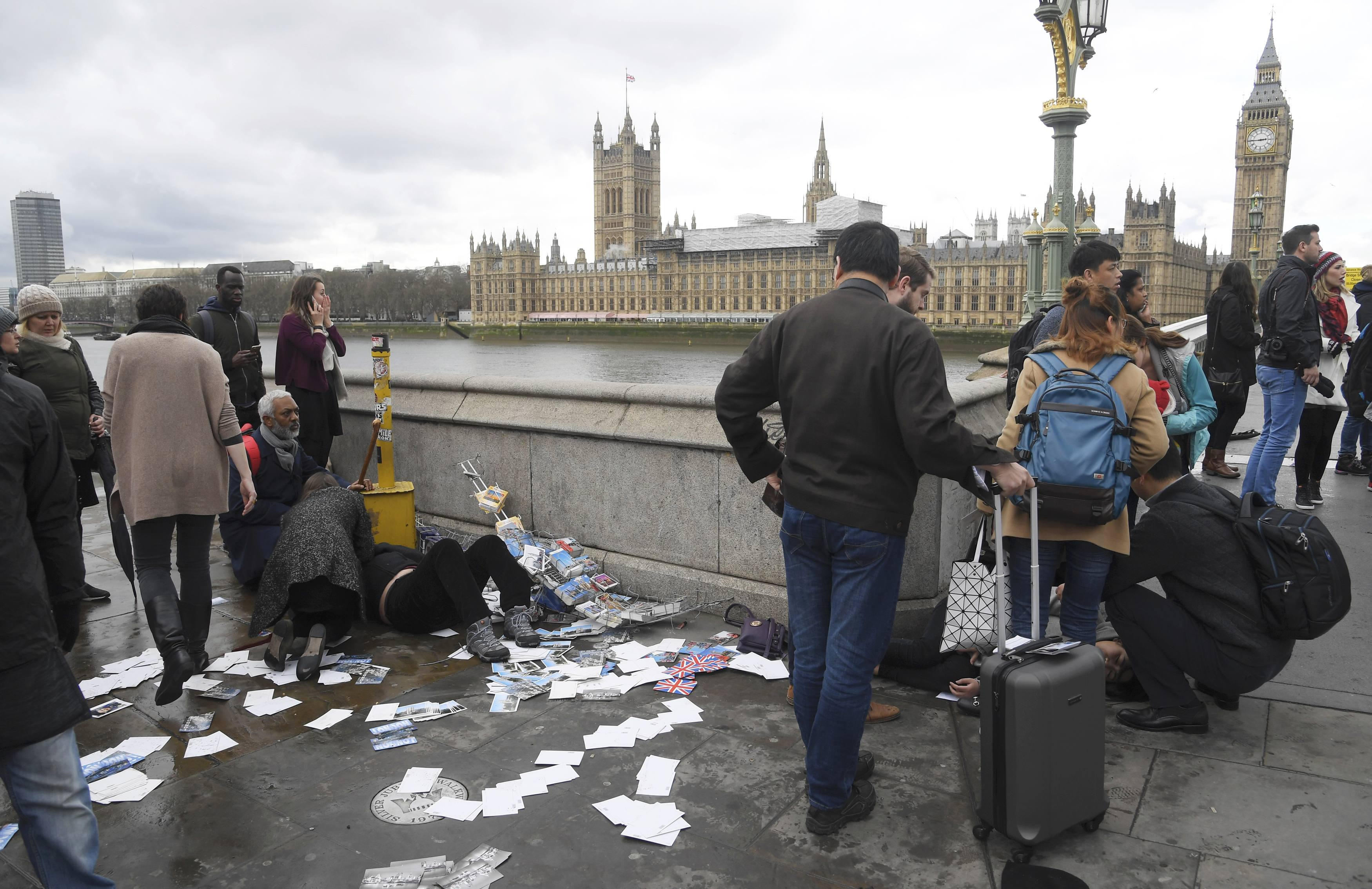 Injured people are assisted after an incident on Westminster Bridge in London on March 22, 2017.  (REUTERS/Toby Melville)