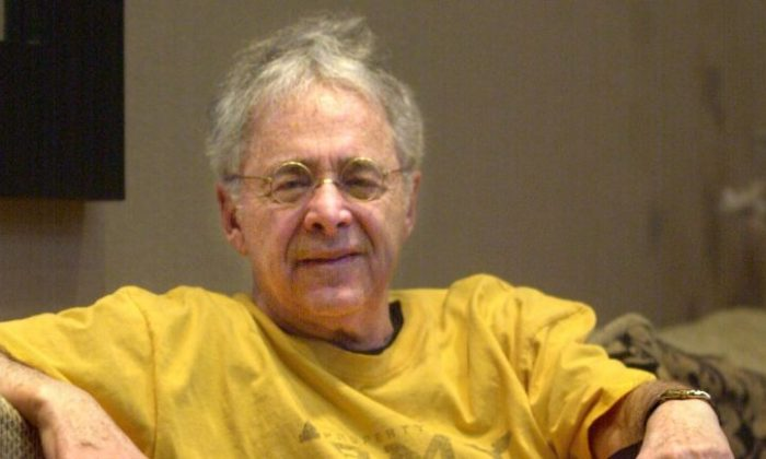 """In this Dec. 20, 2002 file photo, Chuck Barris, the man behind TV's """"The Dating Game,"""" poses in the lobby of his apartment in New York.   (AP Photo/Bebeto Matthews, File)"""