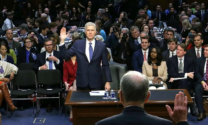 Senate Judiciary Committee Chairman Charles Grassley (R-IA) (back to camera) swears in Judge Neil Gorsuch during the first day of his Supreme Court confirmation hearing before the Senate Judiciary Committee in the Hart Senate Office Building on Capitol Hill in Washington on March 20, 2017. (Alex Wong/Getty Images)
