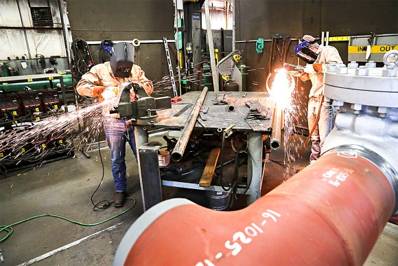 Employees work on building pipes at Pioneer Pipe in Marietta, Ohio, on Oct. 25, 2016. (Spencer Platt/Getty Images)
