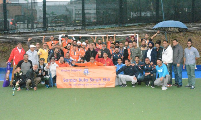 Khalsa players and supporters alike hold up a banner in memory of staunch supporter Sadar Buta Singh Gill who passed away at the start of the year. (Eddie So)