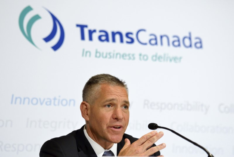 TransCanada President and Chief Executive Officer Russ Girling addresses the media after the Annual General Meeting in Calgary in Alberta on May 2, 2014. (REUTERS/Mike Sturk)