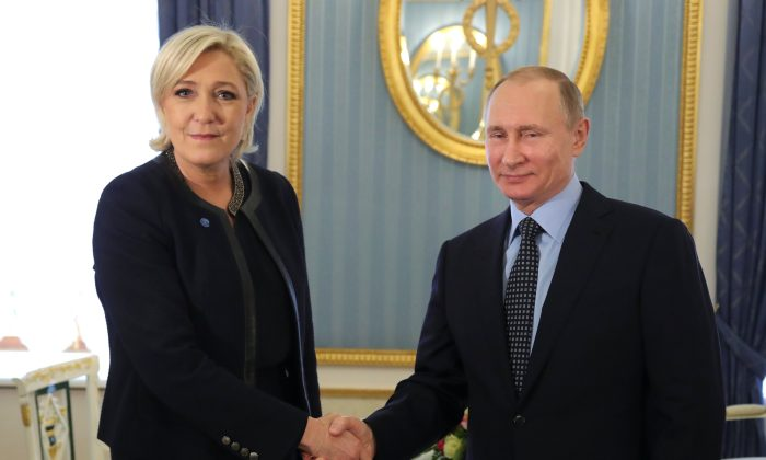 Russian President Vladimir Putin and Marine Le Pen, French National Front (FN) political party leader and candidate for the French 2017 presidential election, during their meeting in Moscow, Russia on March 24, 2017. (Sputnik/Mikhail Klimentyev/Kremlin via REUTERS)